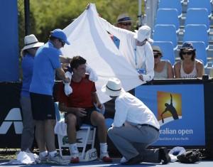 ball-boys-use-a-towel-to-shade-dancevic-from-the-sun